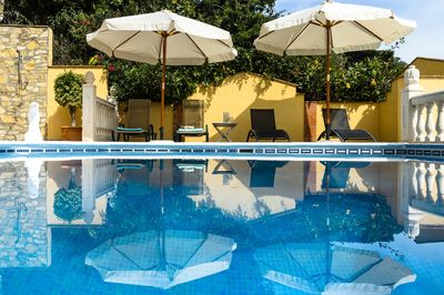 Private pool with sunshades and sun loungers