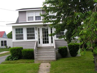 Classic Maine Beach House with lovely sunporch and sitting area in front yard