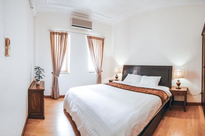 Spacious and warmly lit bedroom where you can relax and recharge your energy
