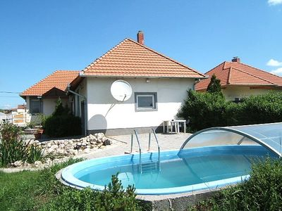 Photo for Holiday apartment only 300m from the beach with pool