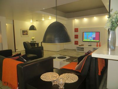 Photo for Feel at home on Copacabana's seafront - 1 suite + 1 bedroom