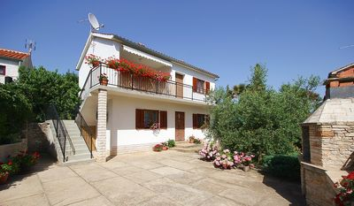 Photo for Nice apartment only 900 meters to the sandy beach with air conditioning, washing machine, barbecue area