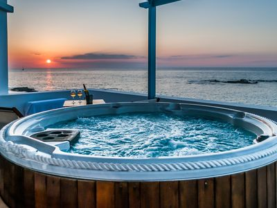 Photo for Luxurious oceanfront villa with unique sunset & hot tub