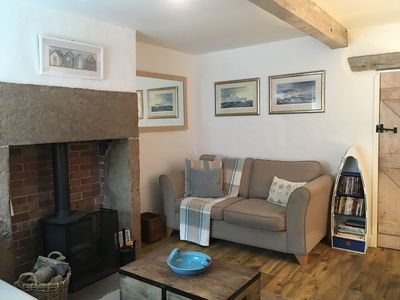 Photo for Delightful Grade II Listed cottage in Historic village - August available.