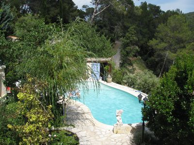 Photo for Provencal farmhouse in natural stones in a wooded hill with swimming pool.