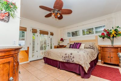 Completely remodeled bedroom.  Lots of windows and doors lets the sun shine in!