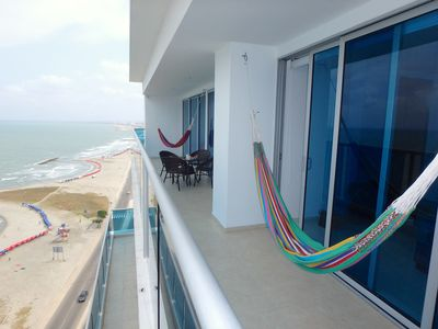 Balcony goes the length of the apt--2 hammocks, table & chairs, beachfront!