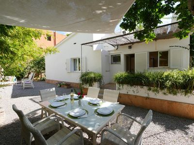 Photo for The pretty cottage is immediately visible from the street, you need n