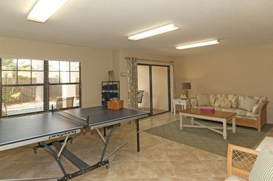The Game Room is adjacent to the Pool and features a sleeper sofa and full bath.