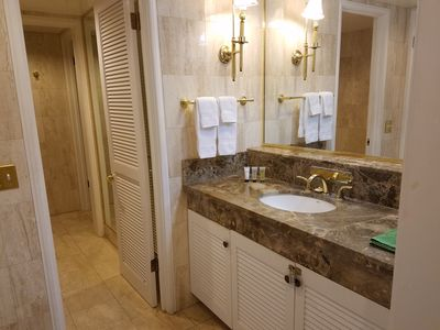 Marble Bathroom with Separate Tub and Shower.