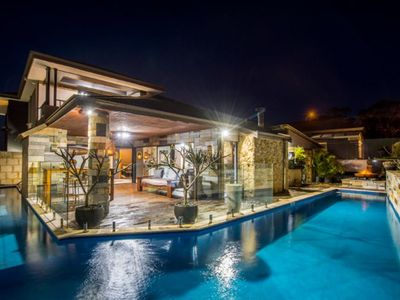Photo for Resort style property situated on the Cut Golfcourse with unique designer pool.
