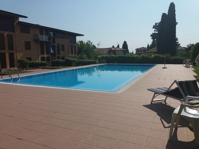Photo for Modern apartment with pool, sleeps 5, near lake and center - Wi-Fi