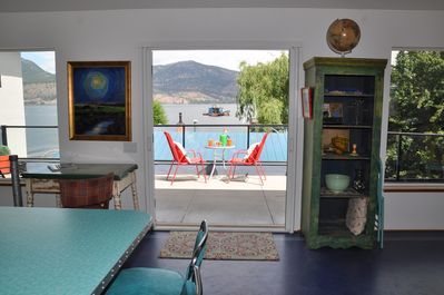 Bright living space and large deck, all with panoramic lake views