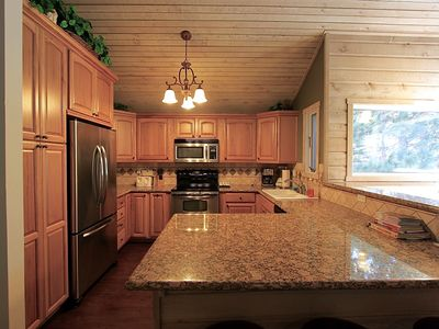 Photo for Snowcreek #22. Rustic 4 Season Cabin w/ Updated kitchen and located on the creek