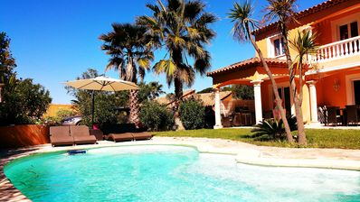 Photo for SunsetVilla quiet 10min walk to the beach Heated Pool and near the Golf