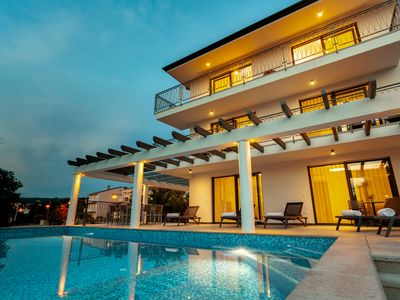 Photo for New villa with large pool, beautiful sea view, 300 meters from the beach