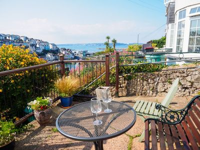 Photo for Delightful 2 bed cottage with sea views, patio, log fire & wi-fi