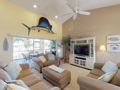 Photo for NEW LISTING! Waterfront retreat w/large dock, private hot tub & water views