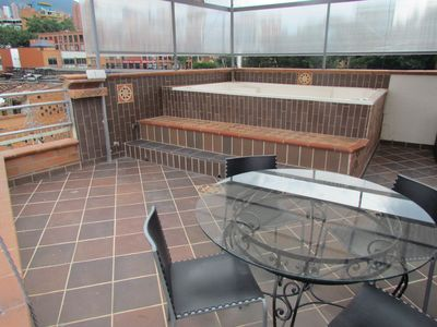 Photo for Penthouse 3 Bedroom AC, Lleras 8 Person Hot Tub, Roof Deck & View