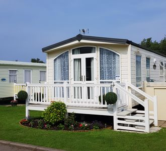 Photo for 6 berth caravan to hire with decking at California Cliffs, Norfolk ref 50060L