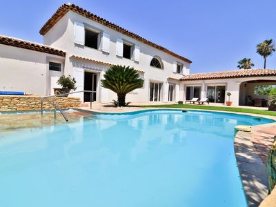 Photo for Large villa with heated pool, 2 steps from the harbor and beaches
