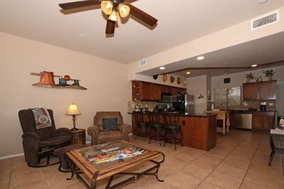Living Room with Kitchen and Counter with 3 Bar Stools
