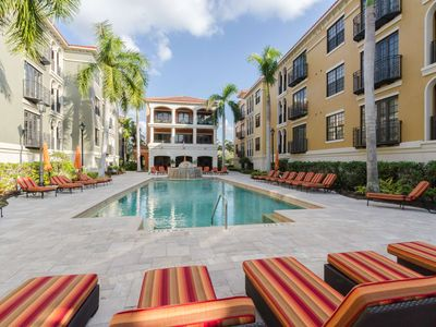 Photo for Newly Listed, Luxurious Lifestyle Condo at Coconut Pointe, Resort Pool, Close to Beaches, Free WiFi