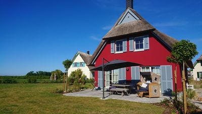 Photo for Thatched house with lake view and large sunny garden - pure relaxation and recuperation