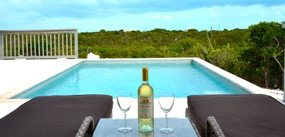 Photo for Seasage Cottage | 2 Bed 2 bath with pool. Ocean view. 3 miles to Grace Bay Beach