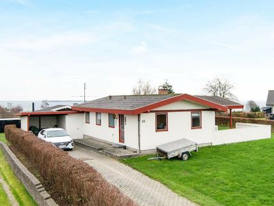 Photo for Comfortable Holiday Home in Jutland with Sunbathing Area
