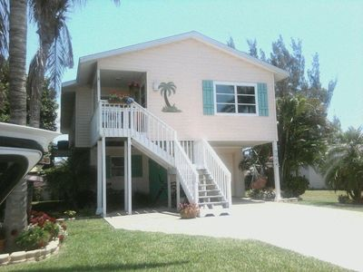 Photo for Adorable Cottage Style Beach Home a few steps from beach and shopping.