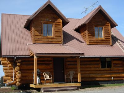 Log home on 5 acre view parcel. Just 5.8 miles from downtown Homer