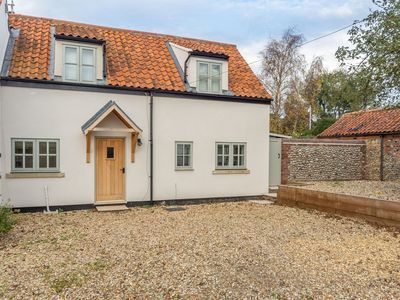 Photo for A delightful cottage with quality, modern accommodation in a coastal village.