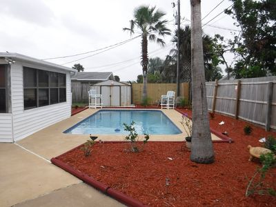 Photo for Beautiful tropical themed pool home walking distance from world famous beach