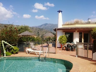 Photo for Spacious villa with great views, peacefully situated between sea and mountains