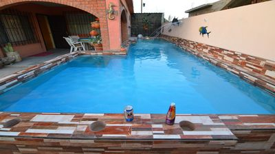 Photo for Huge Family? 5 bedroom sleeps 16 with private pool home!!