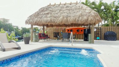 Photo for Canal Front Pool Home with Dockage, Jetted Pool, Tiki Hut, 2 Kayaks & 2 Bikes!