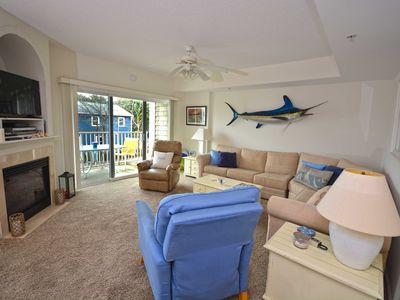 Photo for Beautiful bayfront 2 bedroom luxury condo with free WiFi, an outdoor pool, and a FCFS kayak boat dock located in midtown Ocean City!