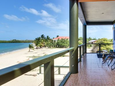 Photo for Oceanfront condo right in town with stunning private beach & tranquility!