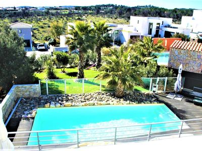 Photo for Villa 160 M2 contemporary, lounge deco. Secured swimming pool. Near Golf