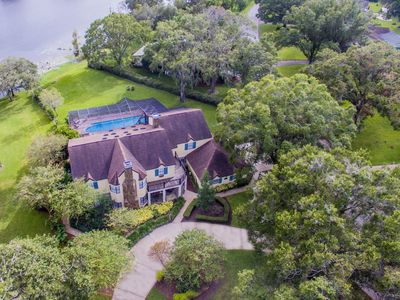 Photo for Majestic Brant Manor: Stately 8 Bdrm, Lakefront Manor w/Htd Pool, 15Min to City