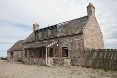 The front of the Farmhouse and the large entrance porch.