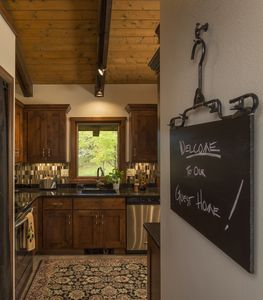 Clever metal blackboard Welcomes You to our remodeled kitchen!