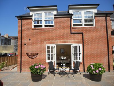 Photo for Luxury Mews House in Tranquil Courtyard. Central Ryde. 5 Minutes Walk to Beach.