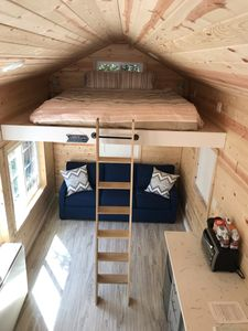 The Tiny House in the City  features brand new king size bed & queen pull out.