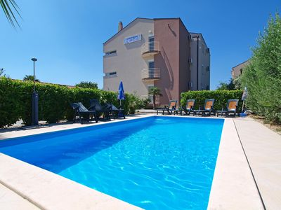 Photo for Cosy apartment with pool, A/C, WIFI, TV, balcony, washing machine and parking