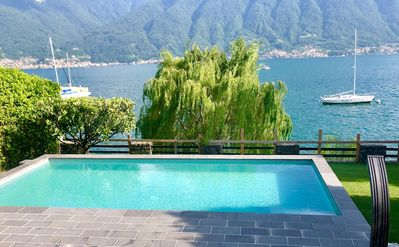Photo for Lakeside villa with private garden and pool. 180° views of the lake and the isl