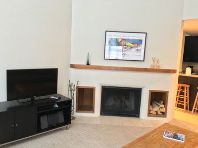 Living Room with wood fireplace & TV
