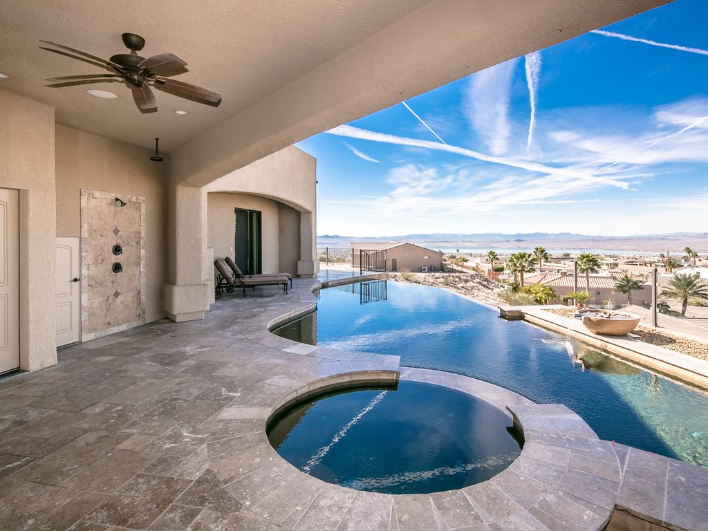 Jaw dropping view 2 master suites pool swim up bar spa for Swim spa in garage