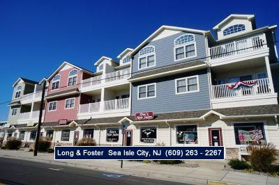 Photo for Gorgeous condo! Located just a short block to a great beach, and conveniently located